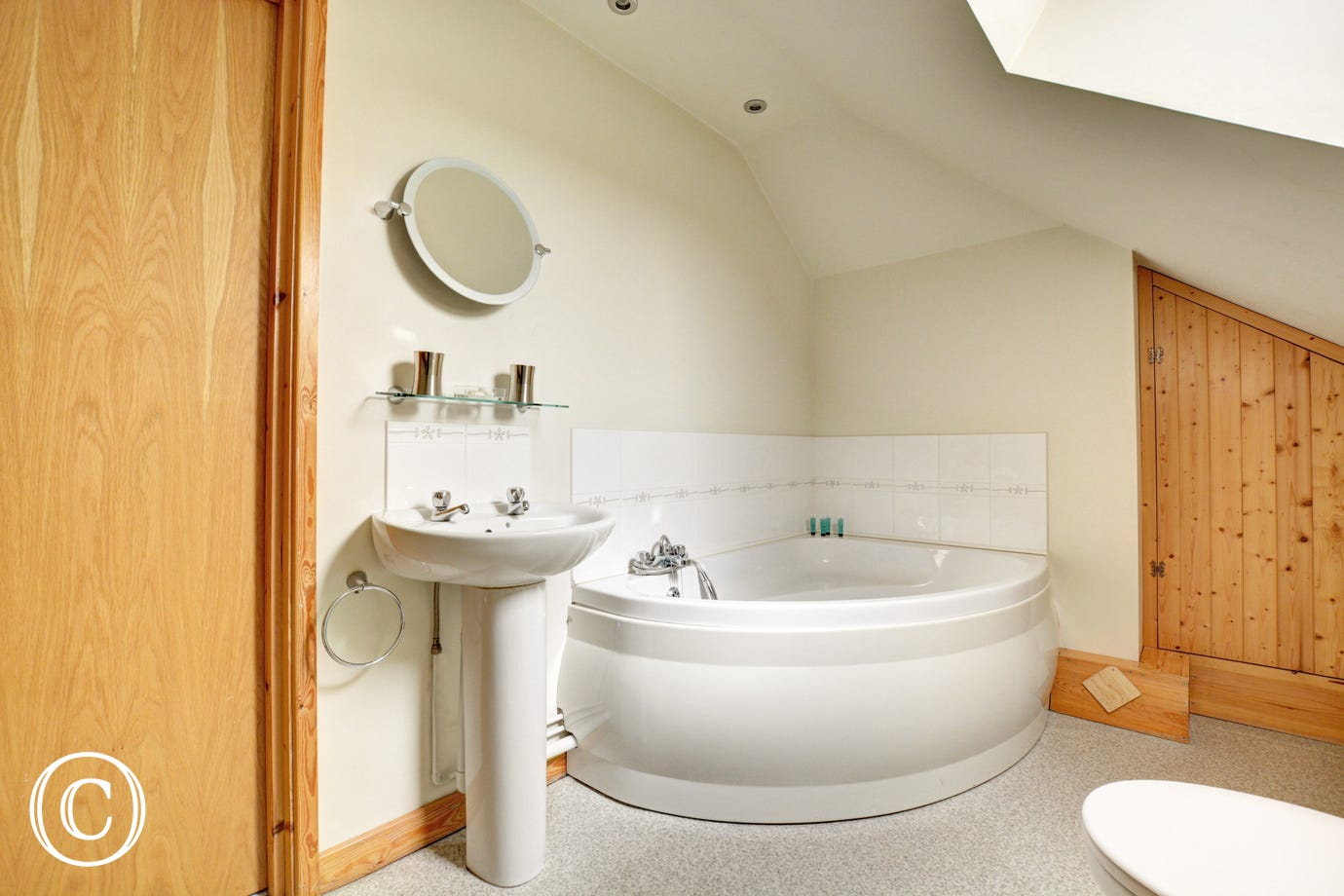 Lovely bathroom with luxurious corner bath