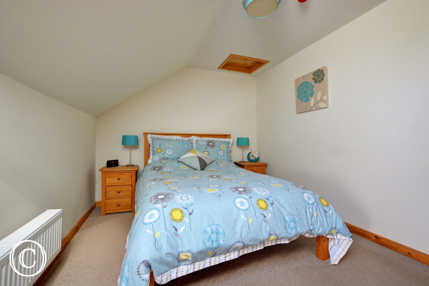 Pretty double bedroom with a double bed and sloped ceilings