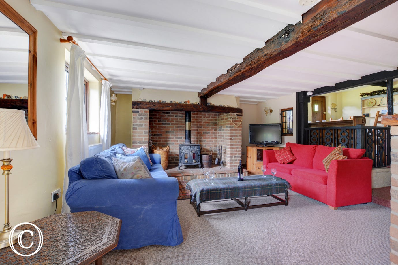 A cosy, traditional sitting room with traditional exposed beams