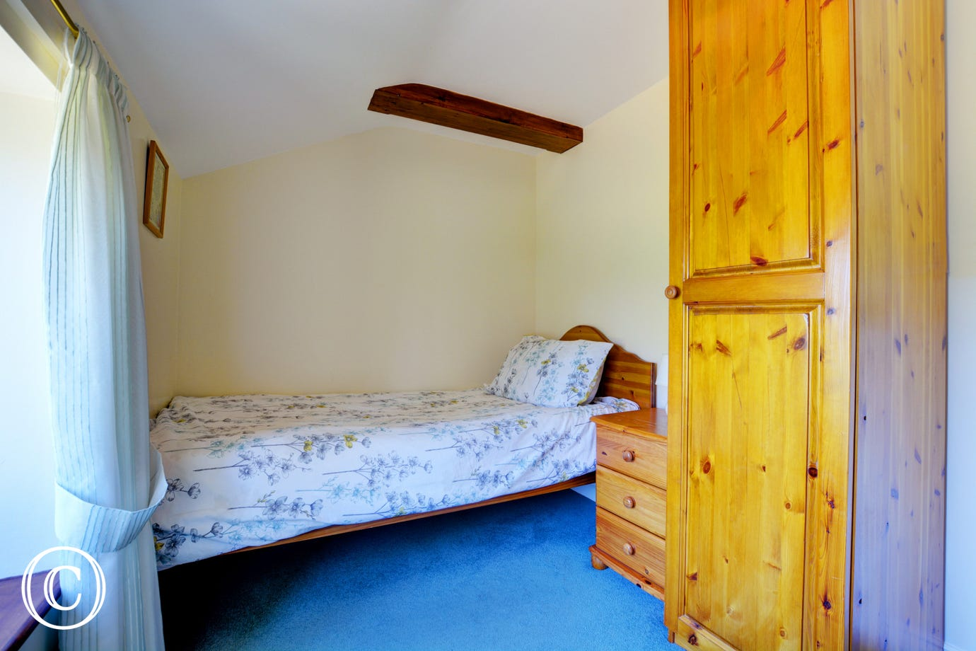 A third bedroom with pine furniture.