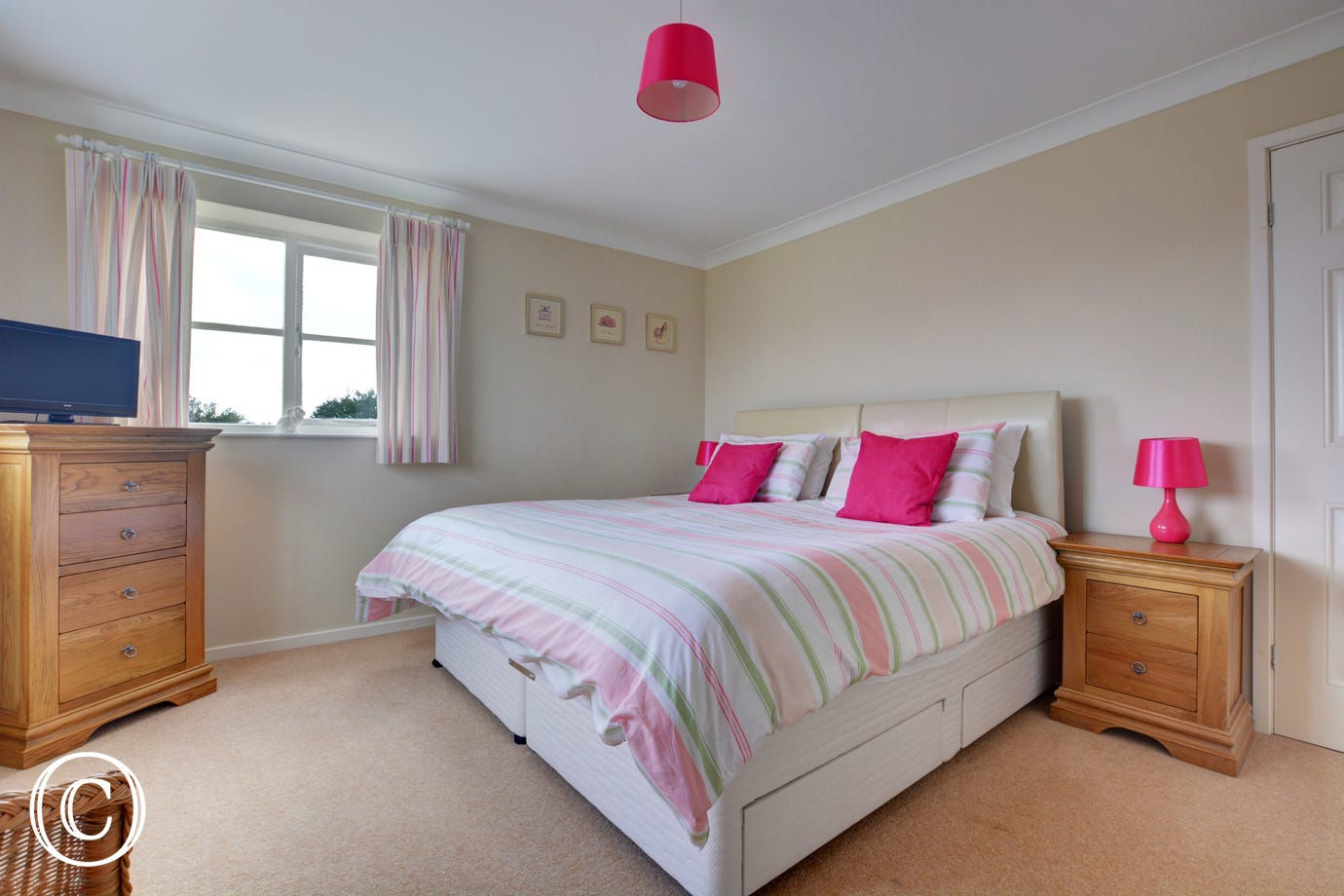 Pretty double bedroom with a king-size zip and link bed which can be made into twin beds on request