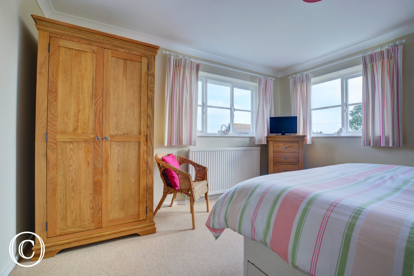 With bedroom furniture providing storage and double aspect windows