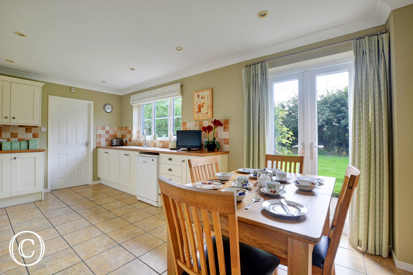 Light, bright and spacious kitchen with most major appliances, well equipped and an additional table and chairs for dining