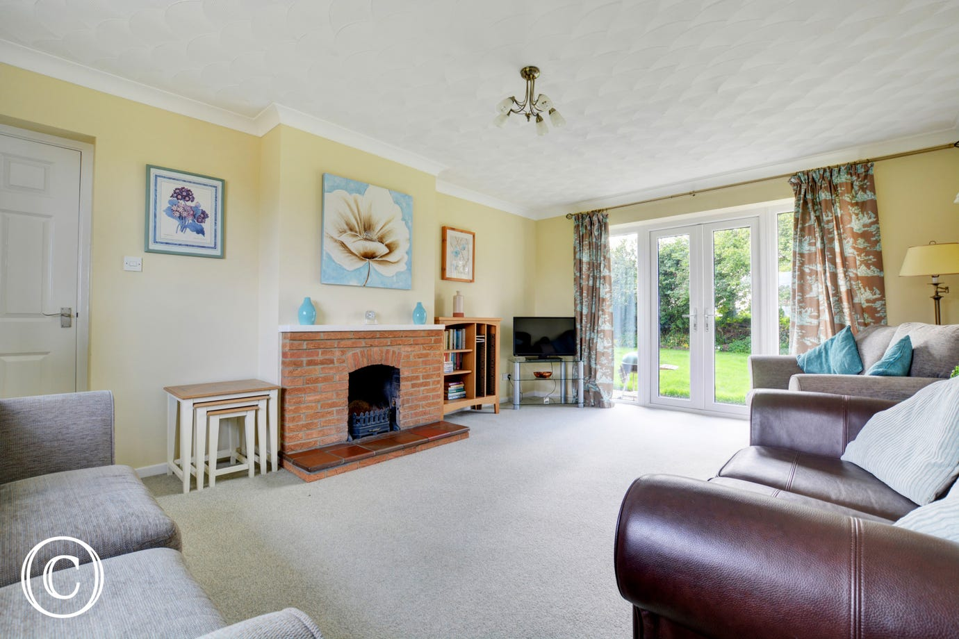Traditionally decorated and furnished with French doors to the garden, this is a lovely family room