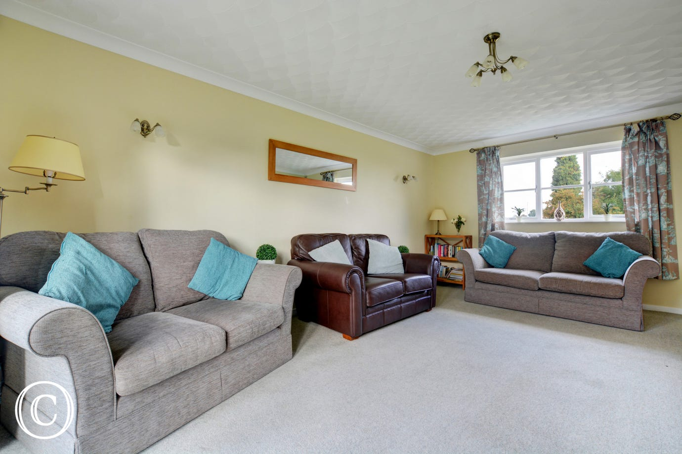 Lovely family sitting room with plenty of comfortable seating.
