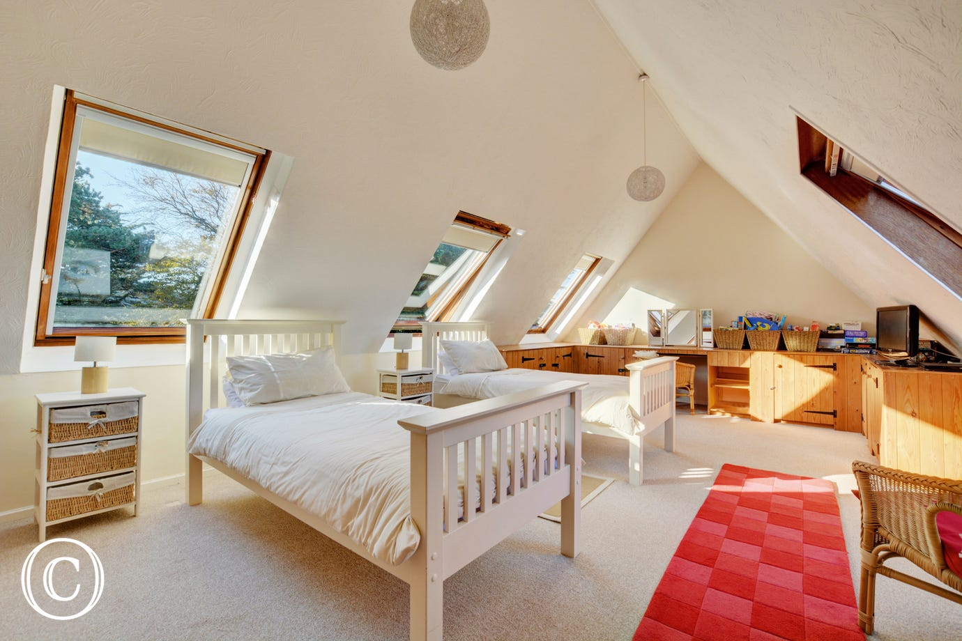 Large studio room with twin beds and velux windows, ideal as a childrens room