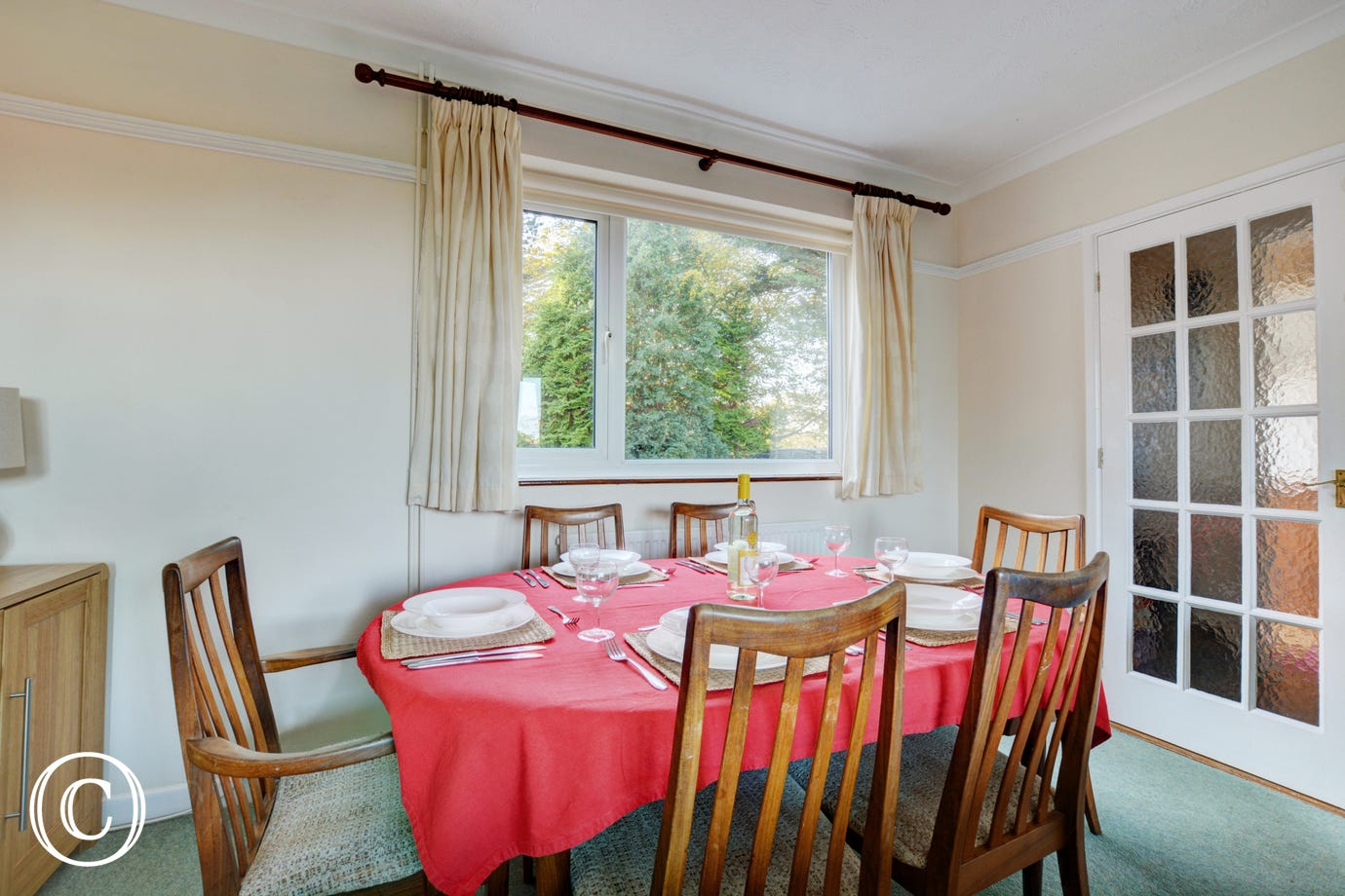 Lovely dining area with a table and chairs for more formal family meals