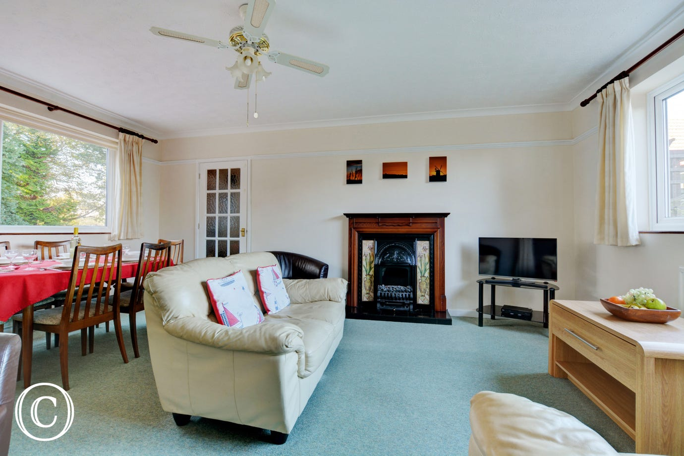 Light and spacious sitting room with an electric living flame fire for cosy evenings