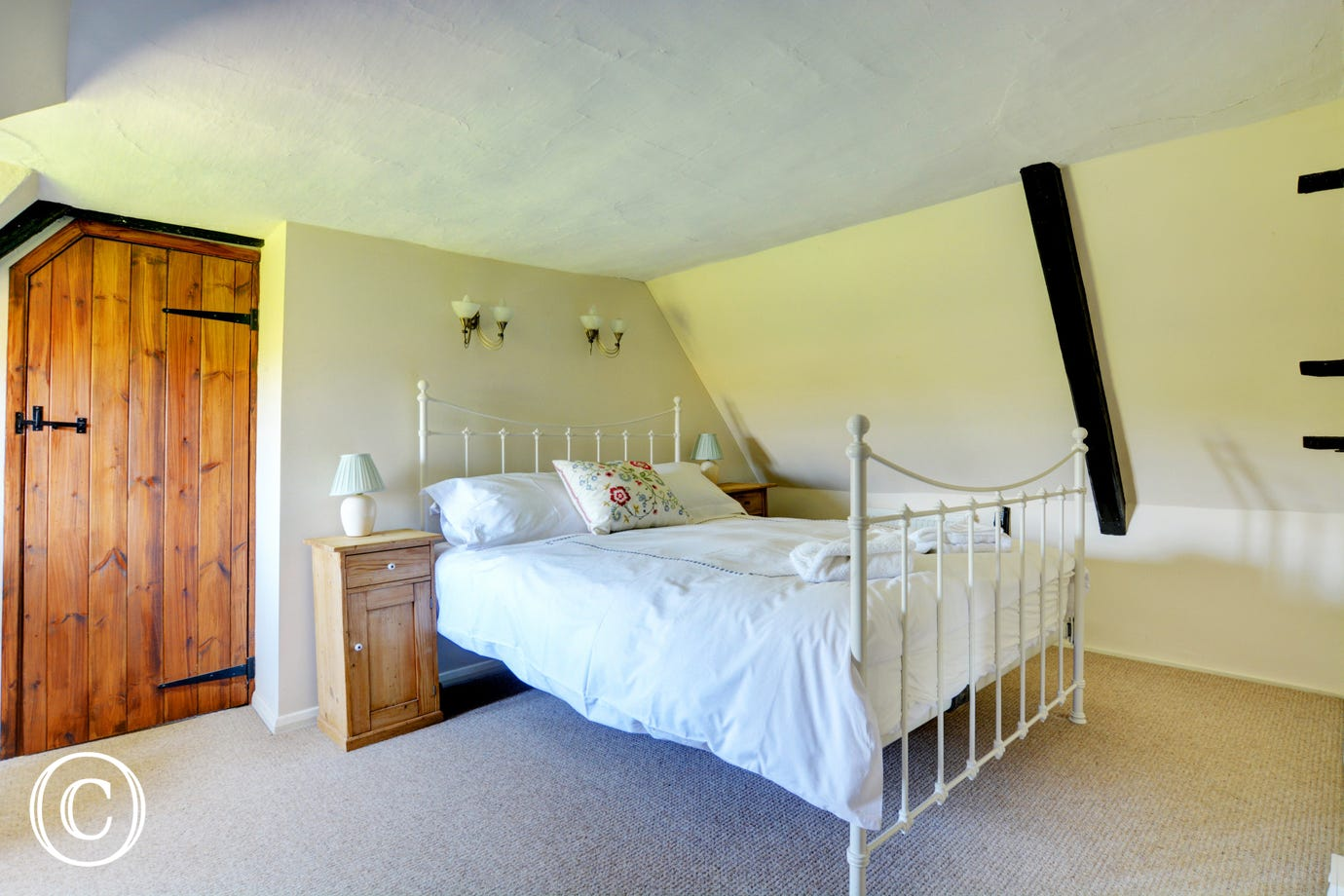 Pretty double bedroom with a traditional wrought iron king size bed