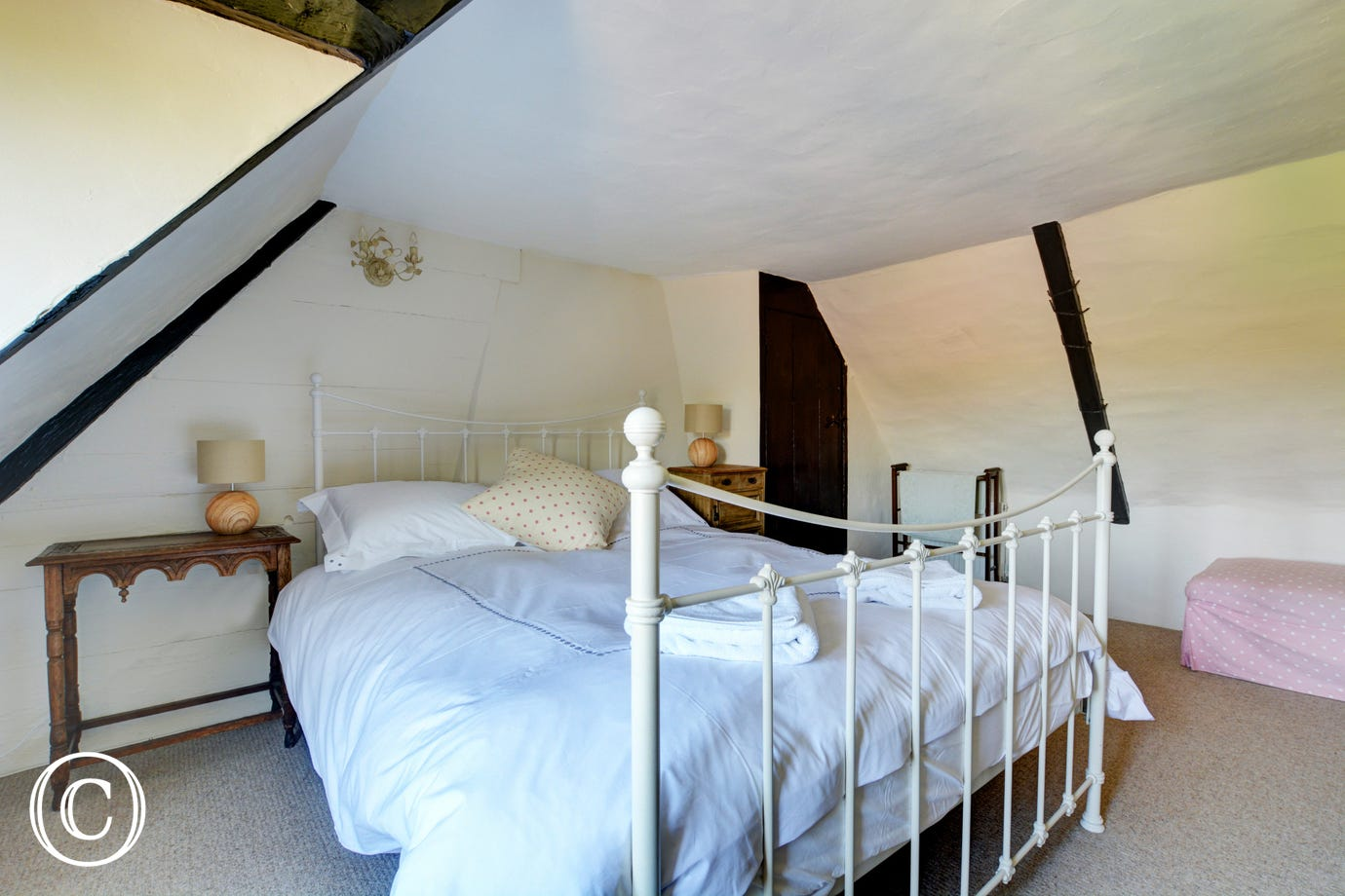 Charming bedroom with a king size bed and views over the fields