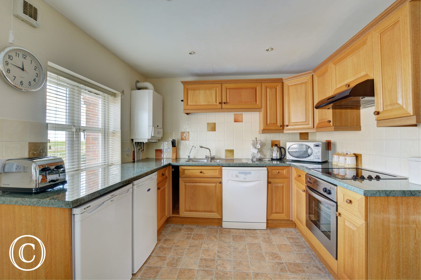 Modern kitchen fitted with all major appliances and the benefit of an utility room in the garage