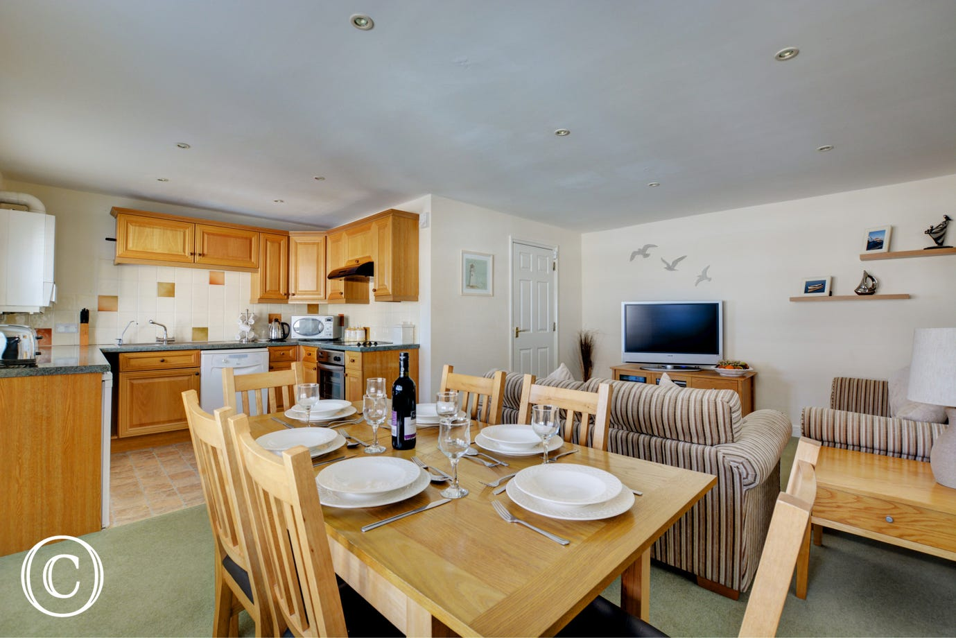 The open plan sitting/dining area is pleasantly furnished with comfortable seating which makes it a lovely family room