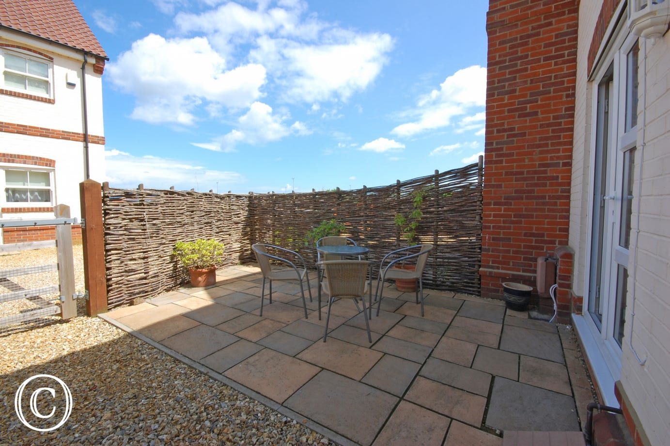 There is a small pleasant patio garden area, ideal for al fresco dining and enclosed by willow fencing to the rear, with integral garage and parking space