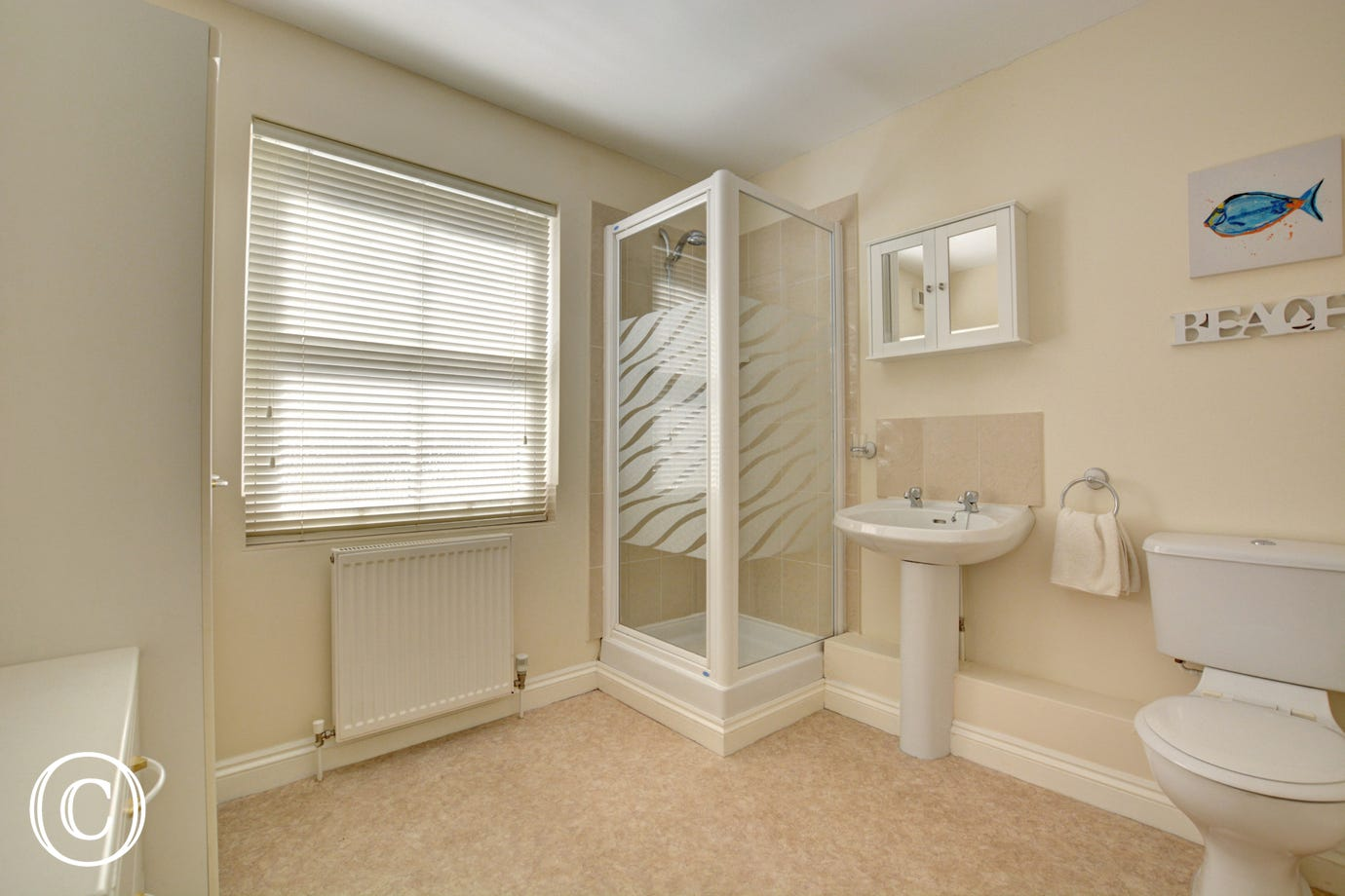 Light and airy shower room with separate cubicle