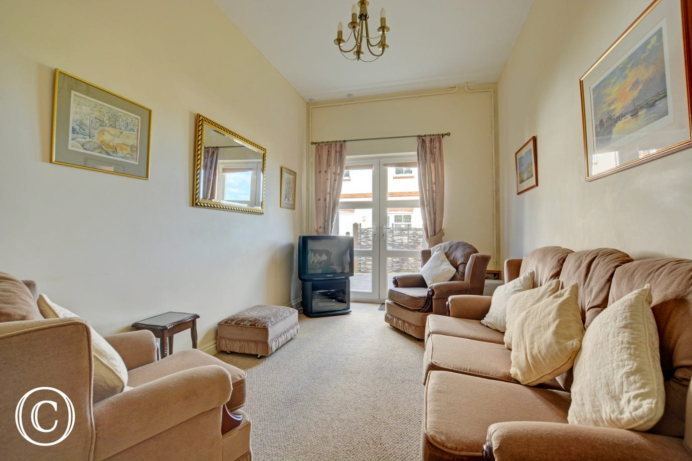 Garden sitting room on the ground floor is comfortably furnished with views over the garden