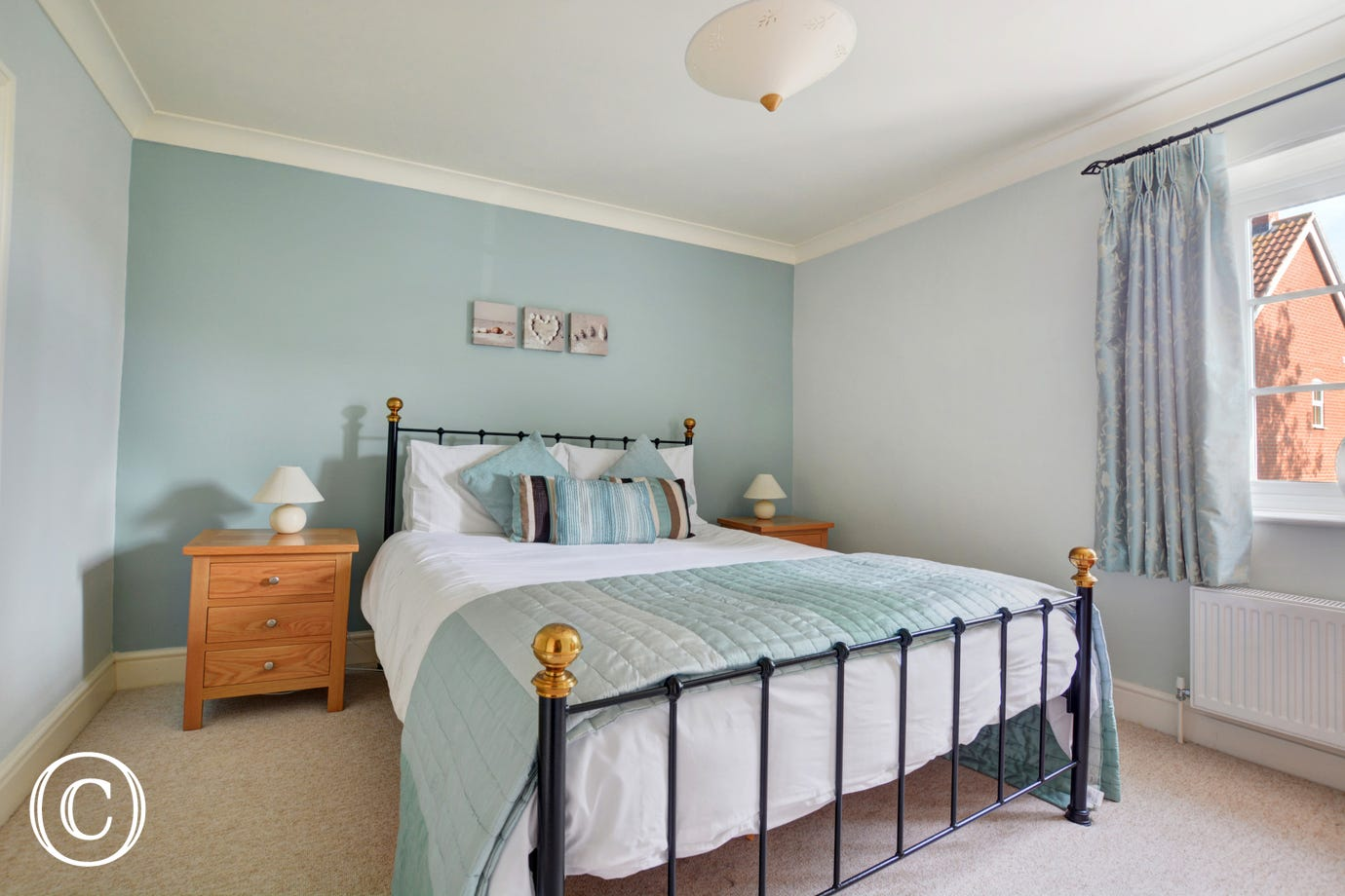 Beautifully decorated bedroom with a king size bed