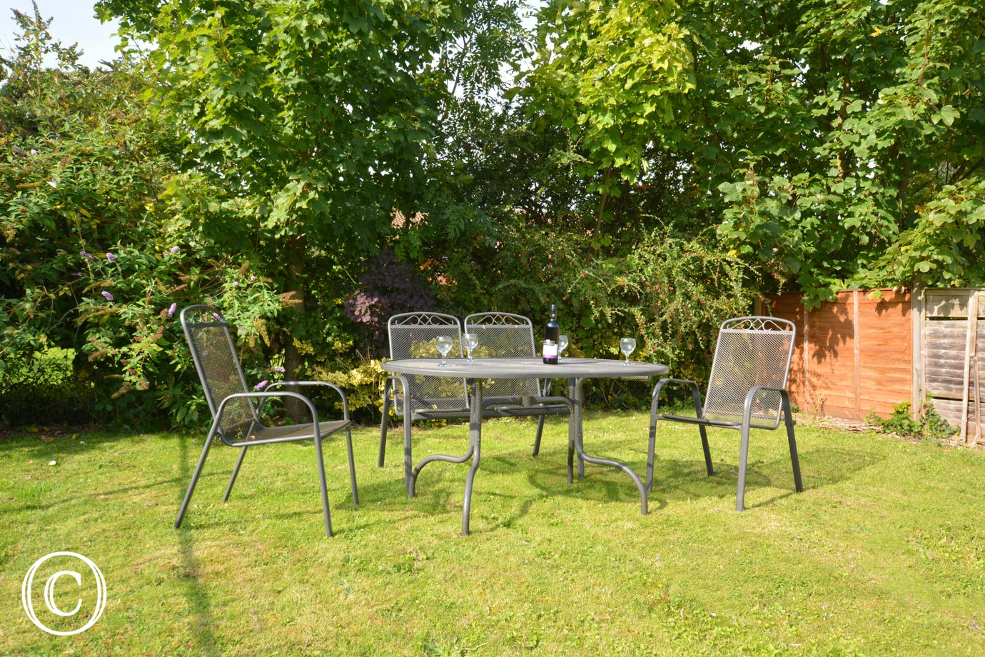 Lovely spacious garden with table and chairs