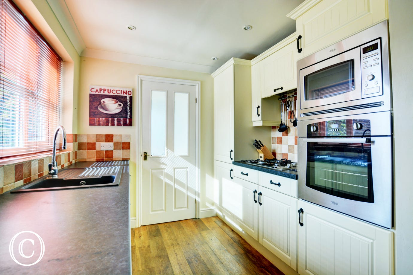 Lovely spacious kitchen with electric fan oven and gas hob