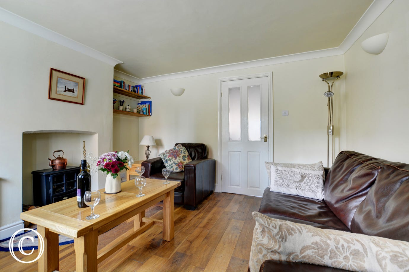Attractively furnished with comfortable seating and an electric living flame fire for cosy evenings