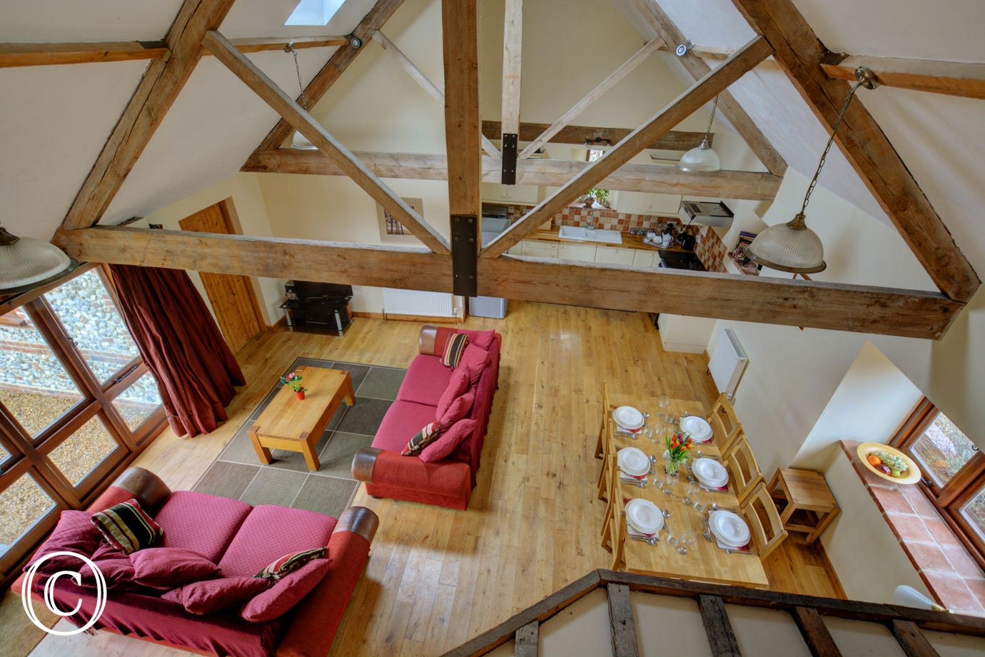 View from the mezzanine showing beams and the spacious open plan living area