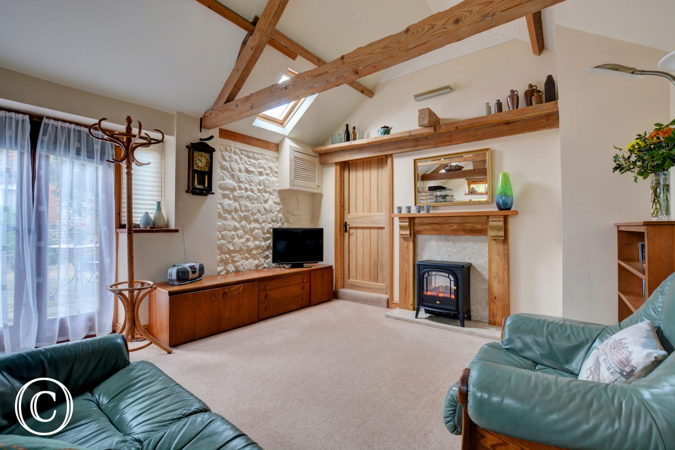 Another view of the sitting room showing the feature fireplace & TV.