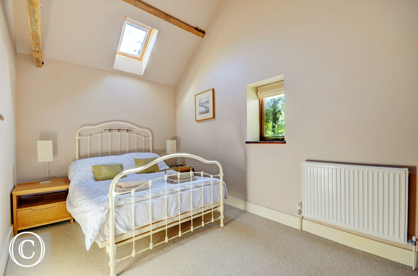 Bedroom three has a double bed with an attractive wrought iron bedstead