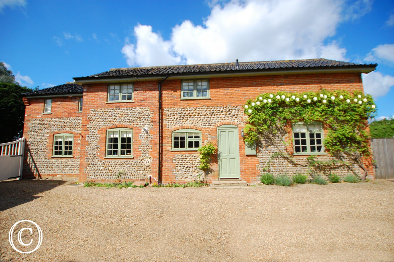 The appealing brick and flint exterior of Knapton Hall Cottage.
