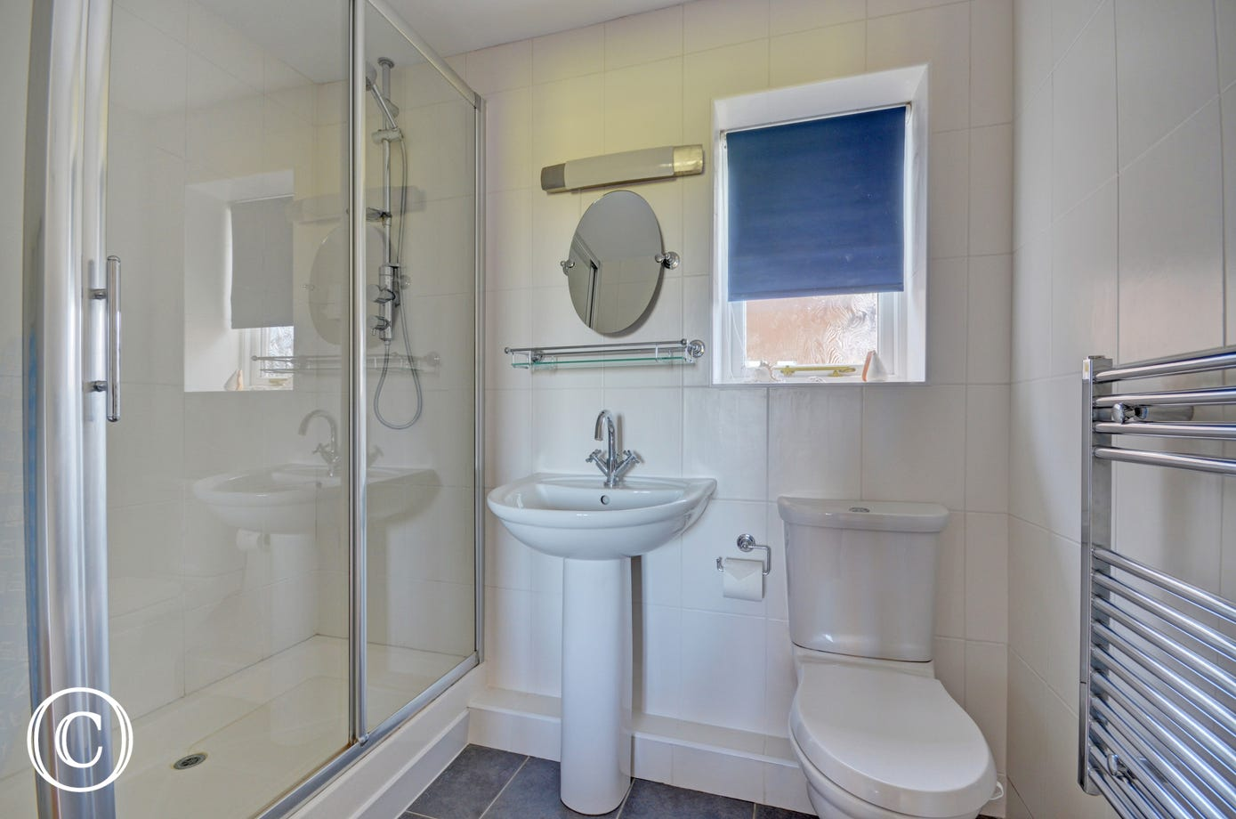A large enclosed shower cubicle.