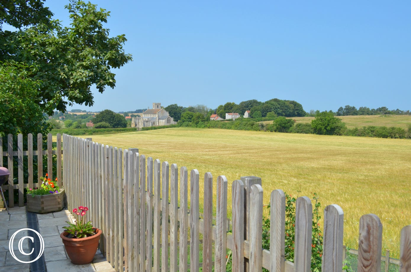 A lovely view across the field to the village of Cley.