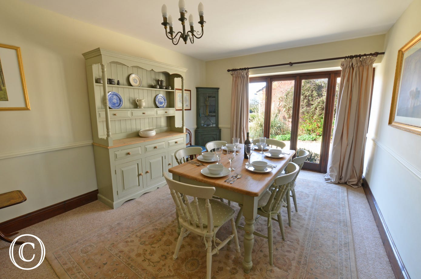 The spacious dining room with a large dresser, table and six chairs. Ideal for a traditional family meal