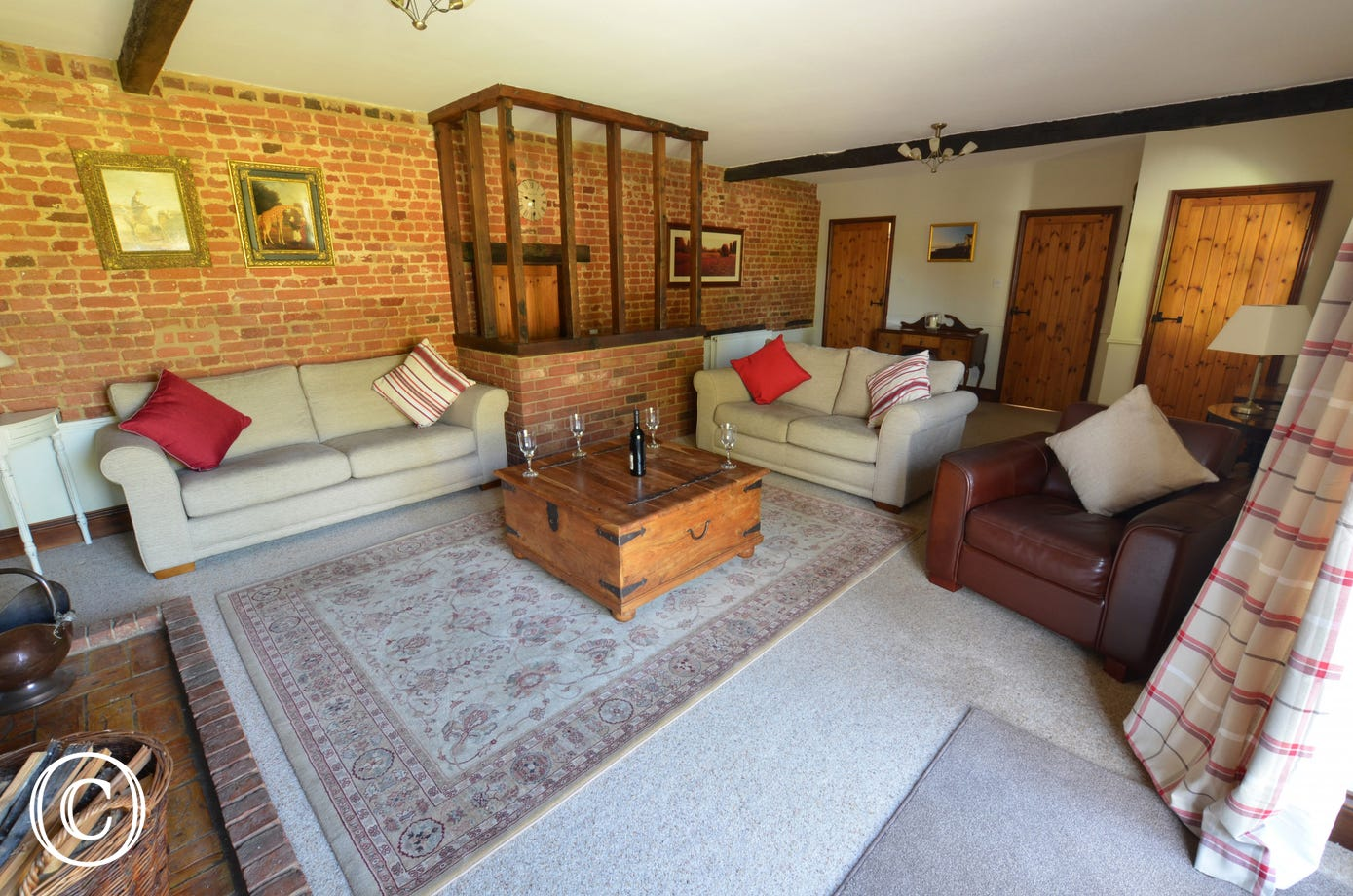 This shows the comfortable seating, original feature exposed brick work and traditional internal doors