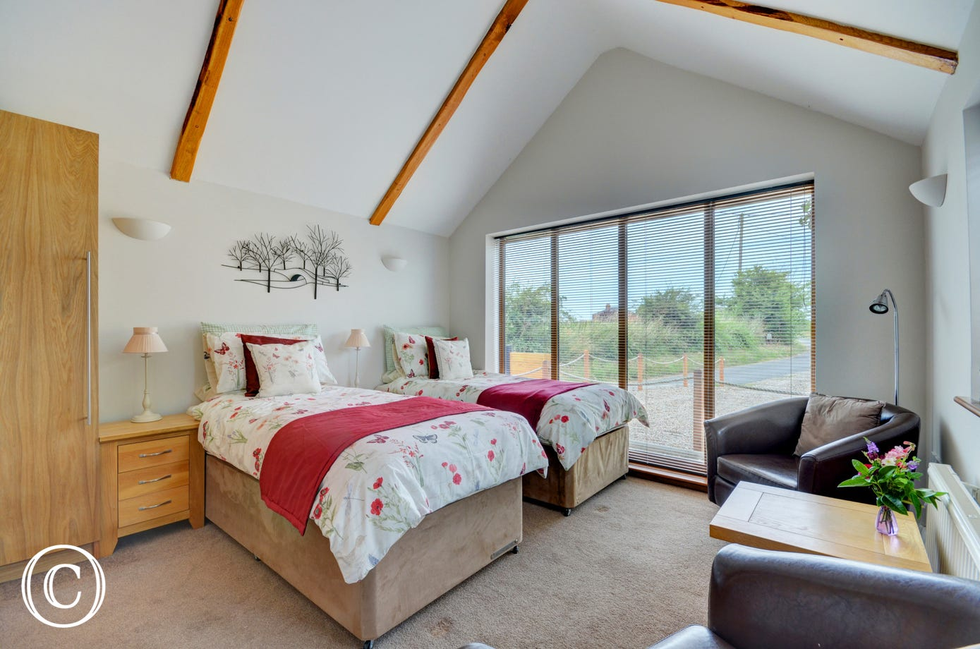 The bed is well-positioned for views through the patio doors.