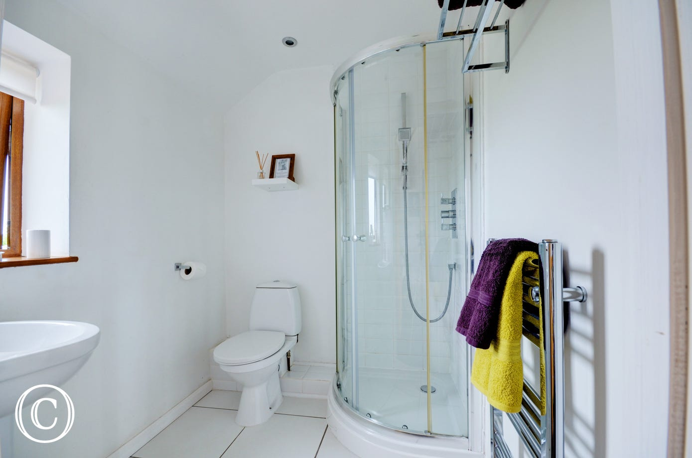 Modern and bright shower room with shower cubicle