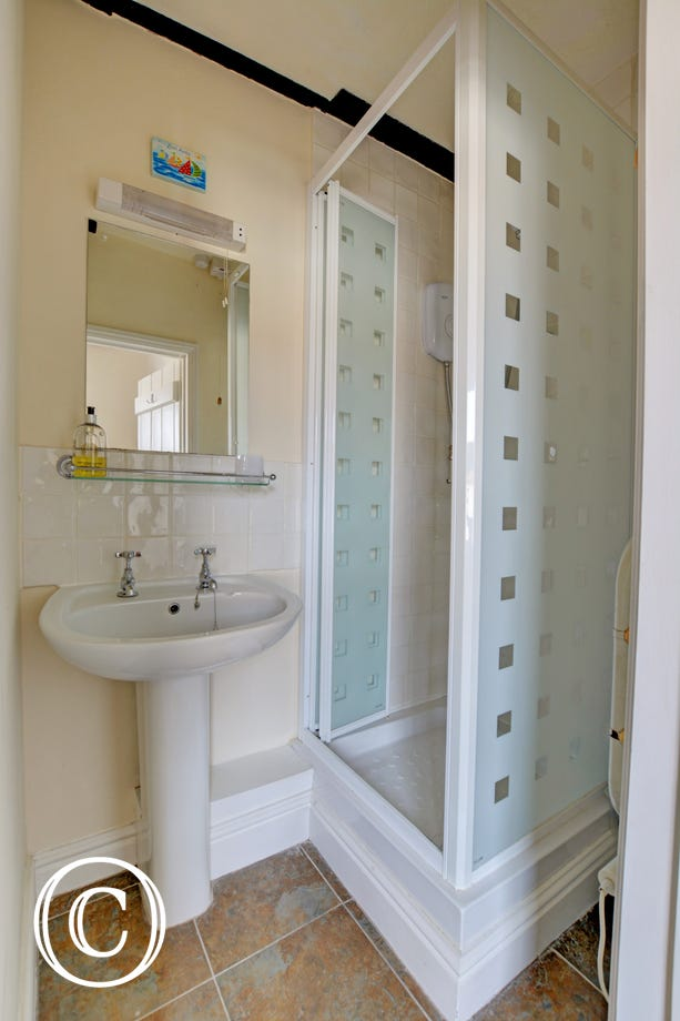 Compact en-suite shower room for double room.