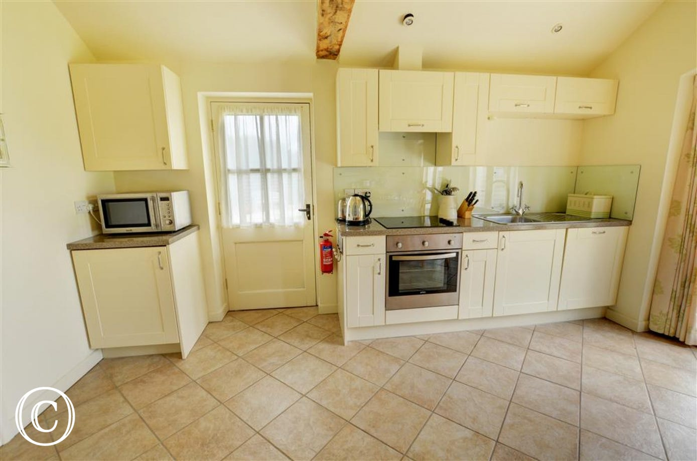 The kitchen is a light room well equipped with all that you might need for your self catering holiday
