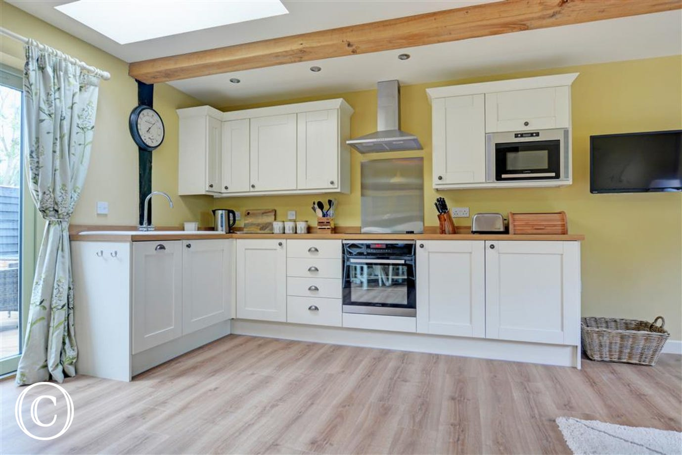 Kitchen area within the open plan room