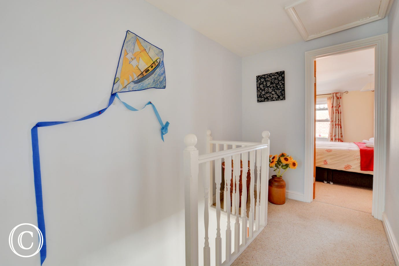 The artwork kite on the wall is quirky and fun.