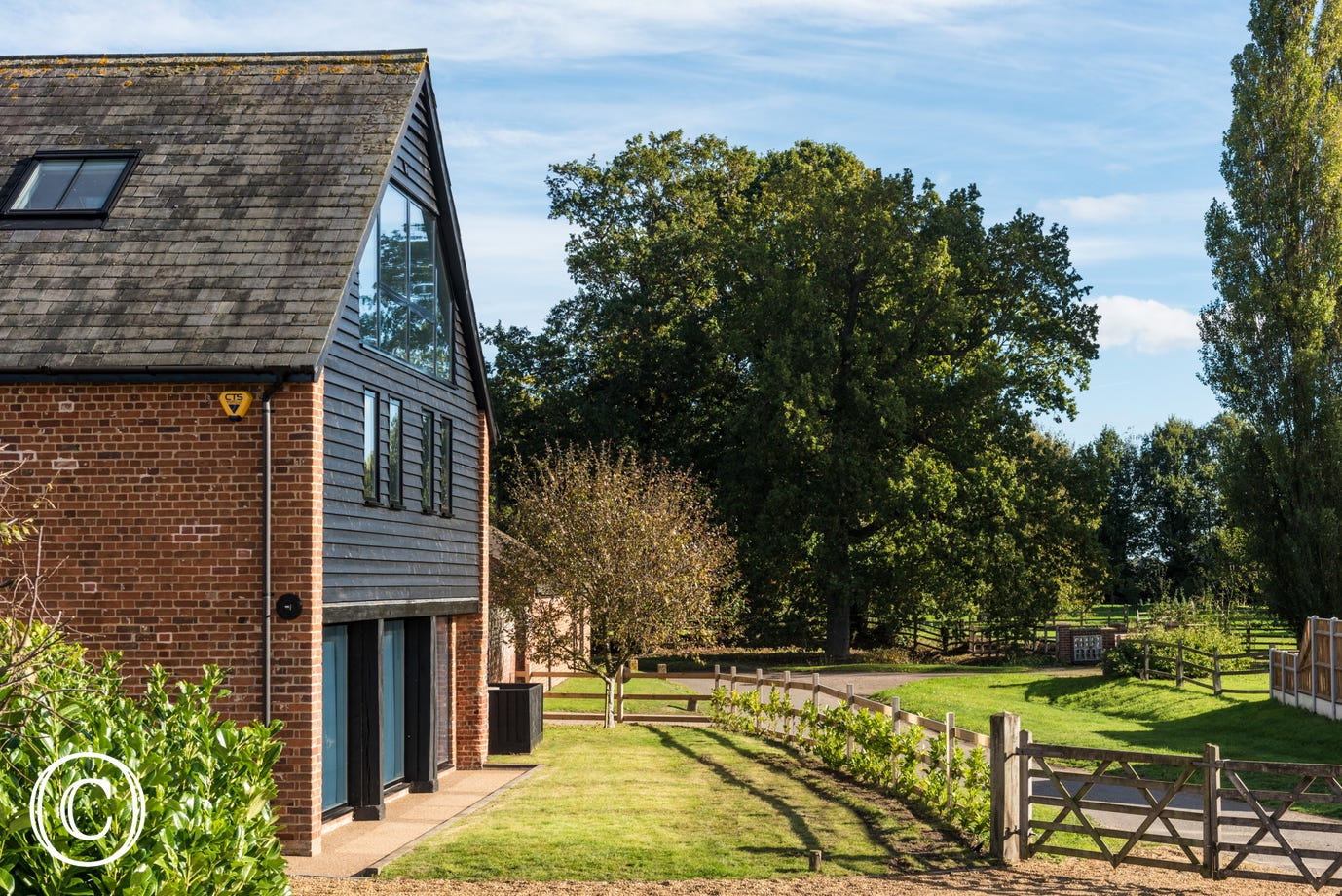 Exterior image of this thatched barn in a stunning rural setting