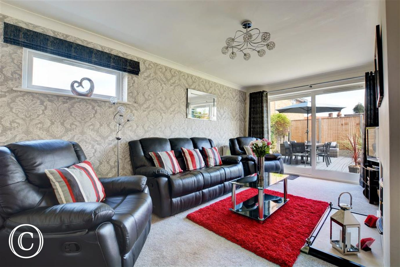 Comfortable sitting room attractively furnished