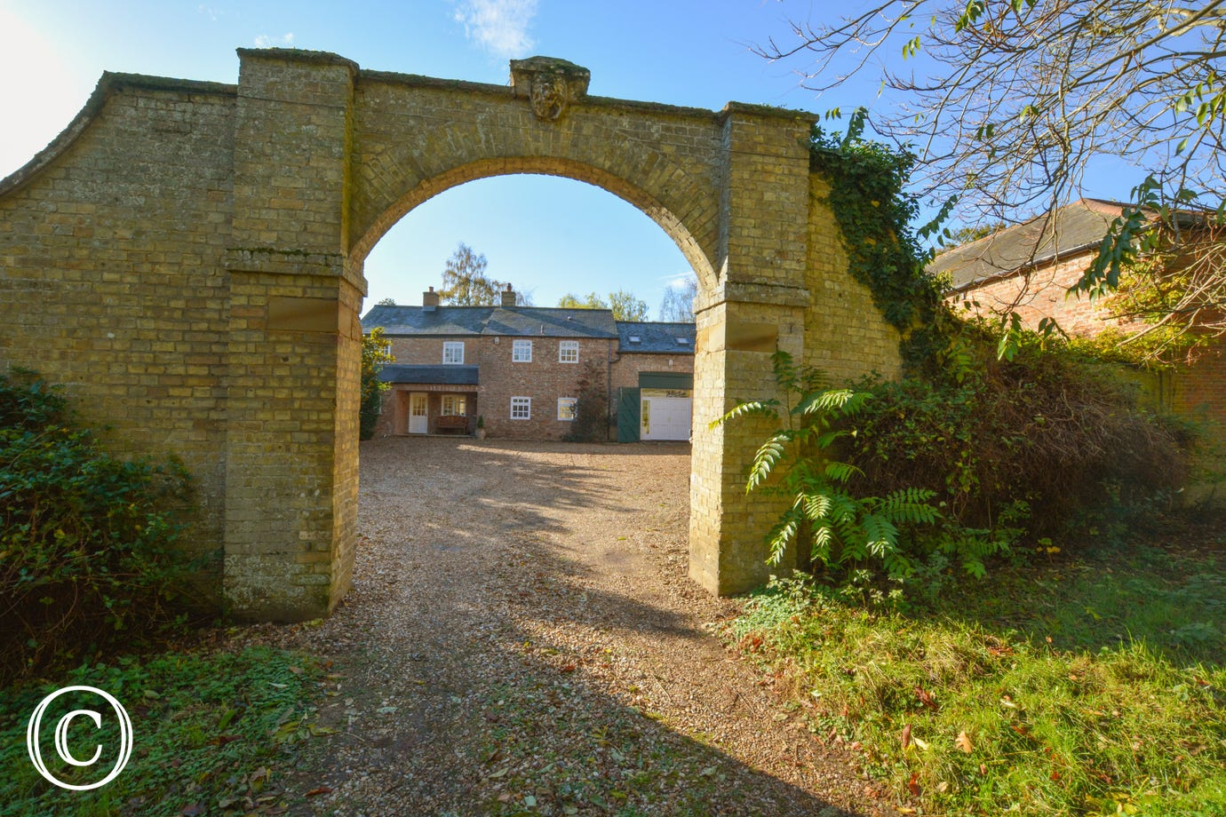 The old stable archway leading to Stable Cottage