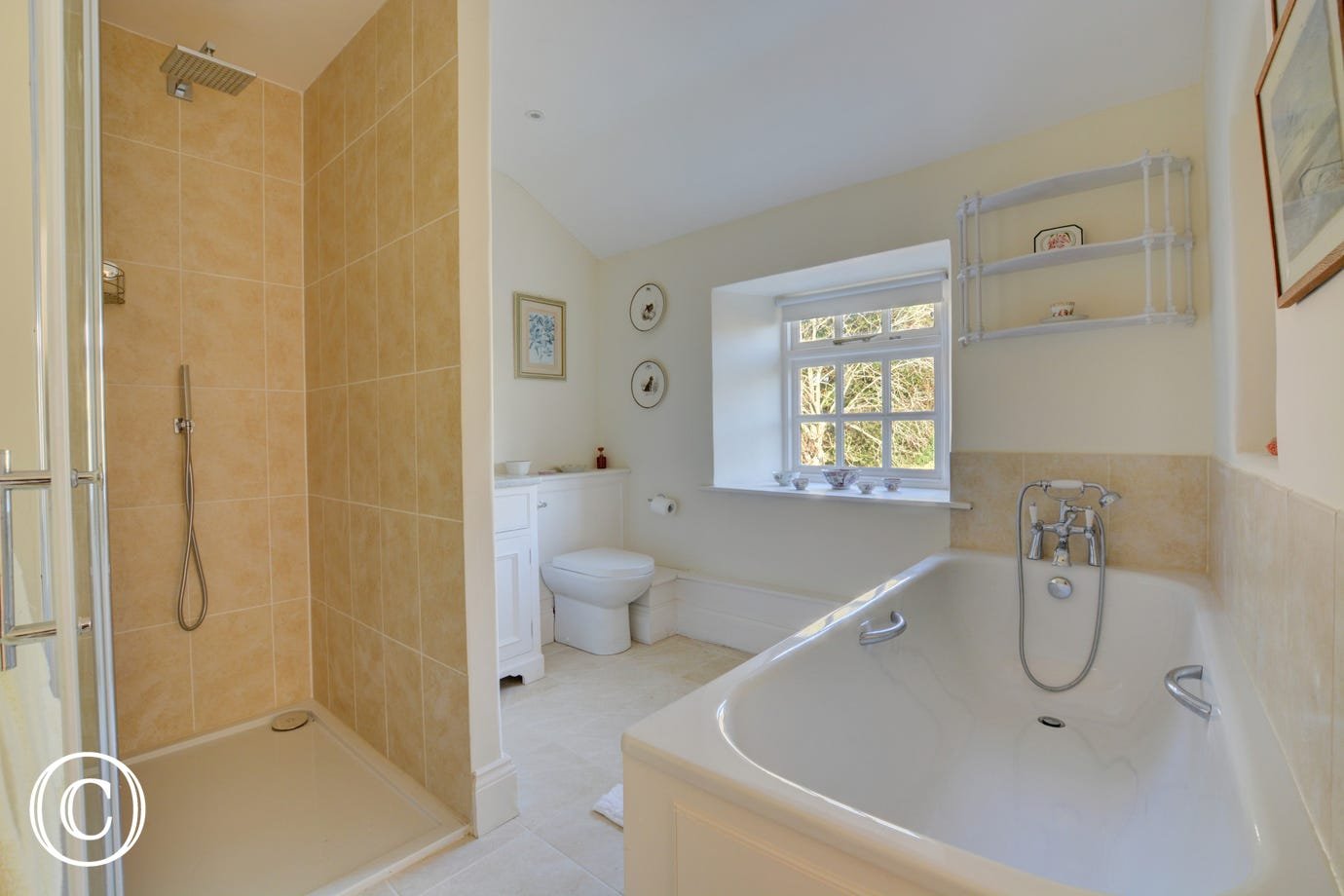 Spacious en-suite bathroom with bath and separate shower