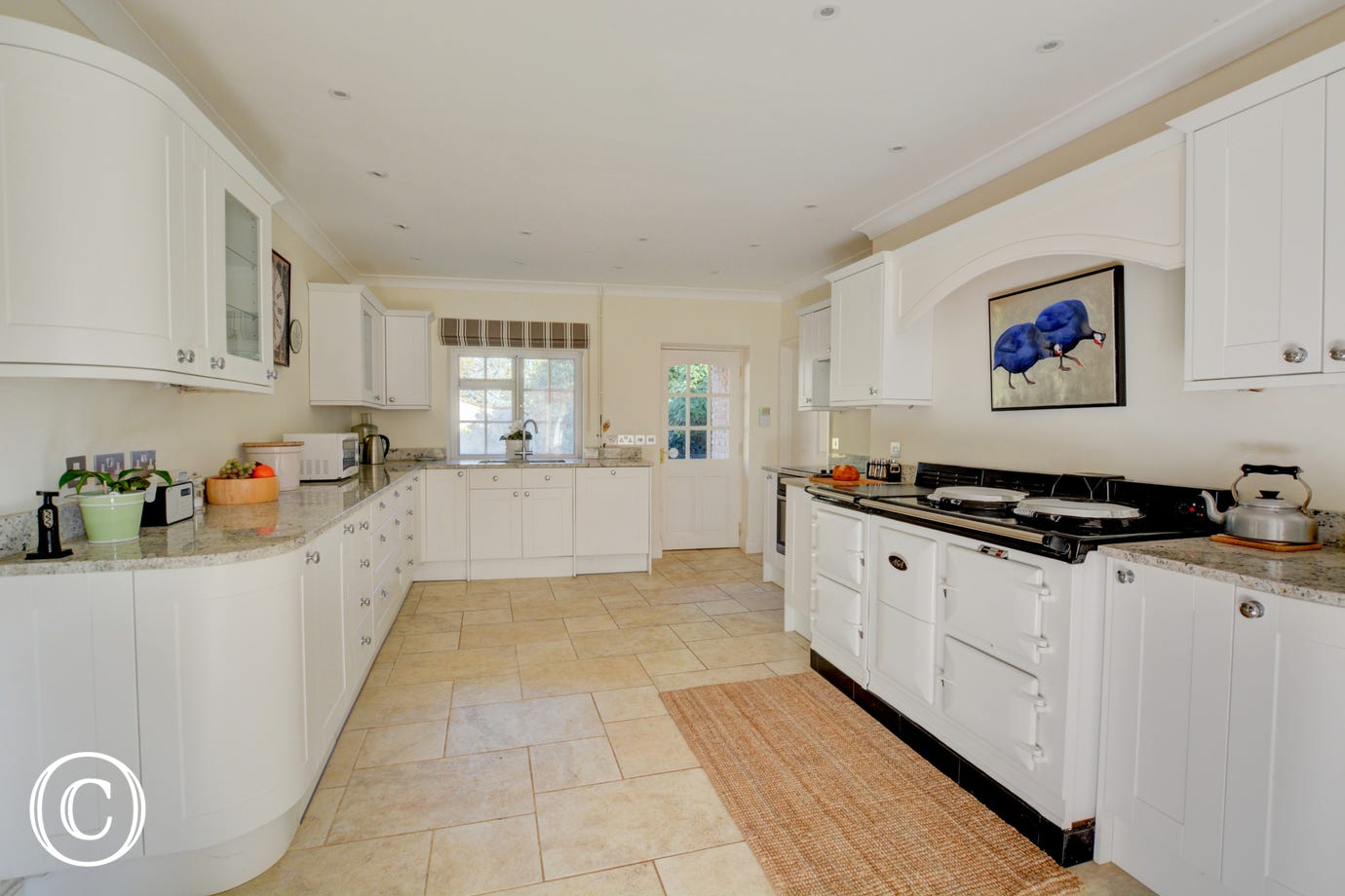 Modern, white kitchen with Aga