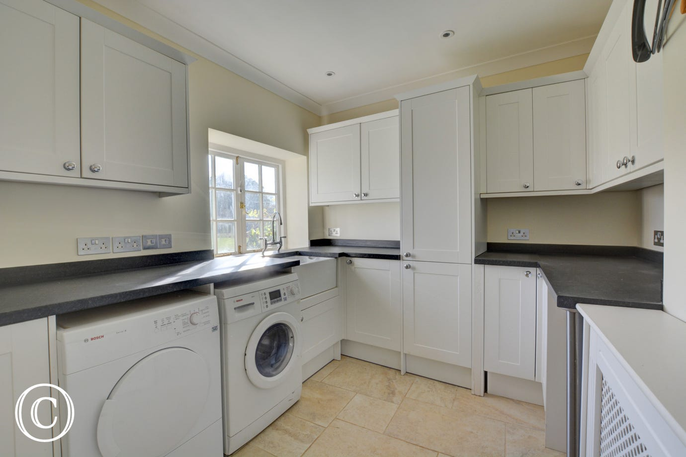 Essential utility room with washing machine, tumble dryer and fridge/freezer