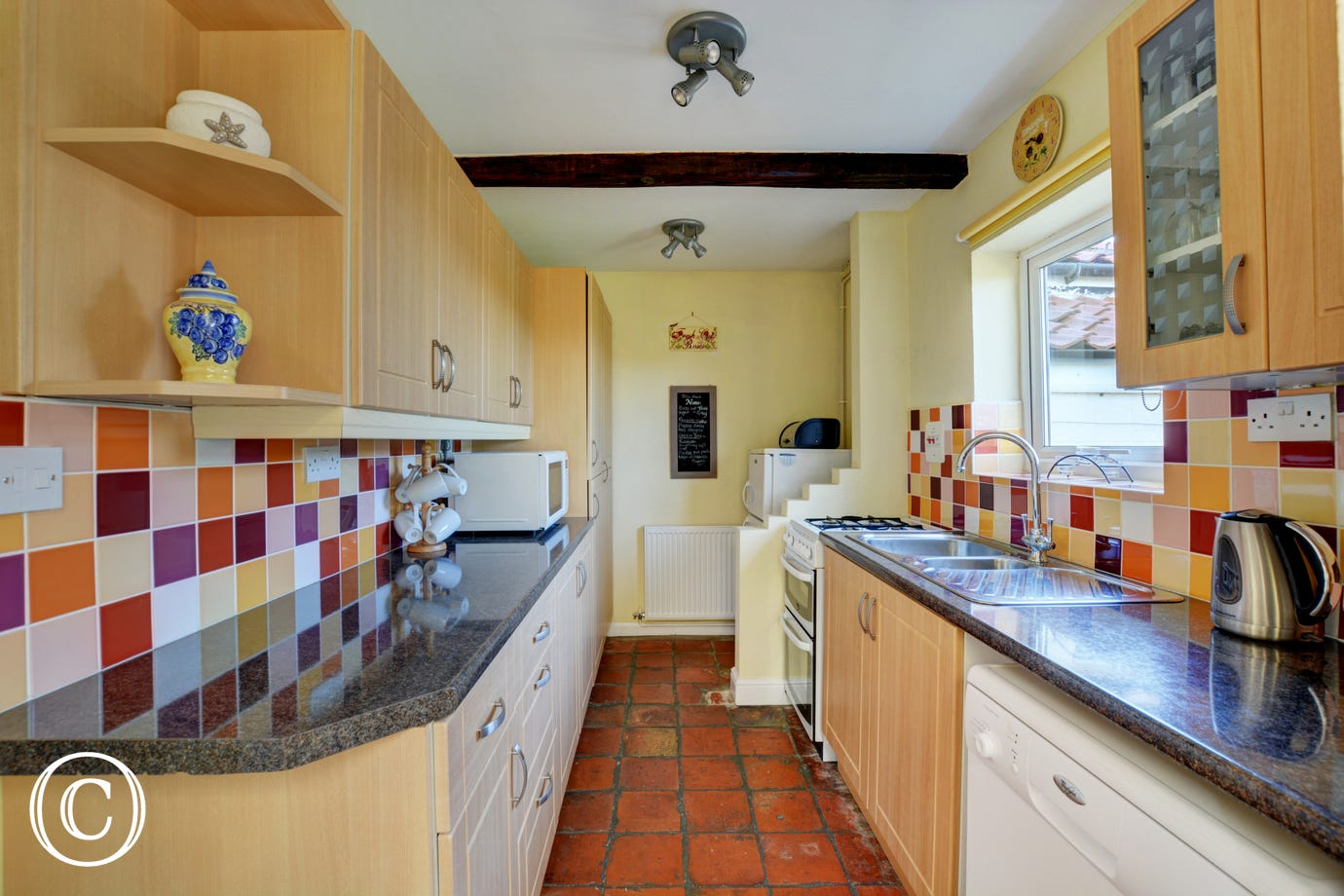 Brightly tiled kitchen