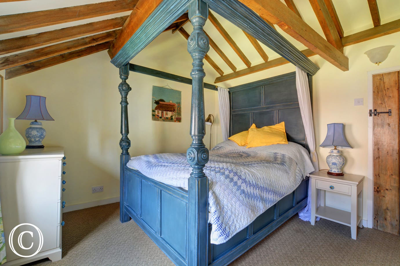Showing four poster wooden bed.