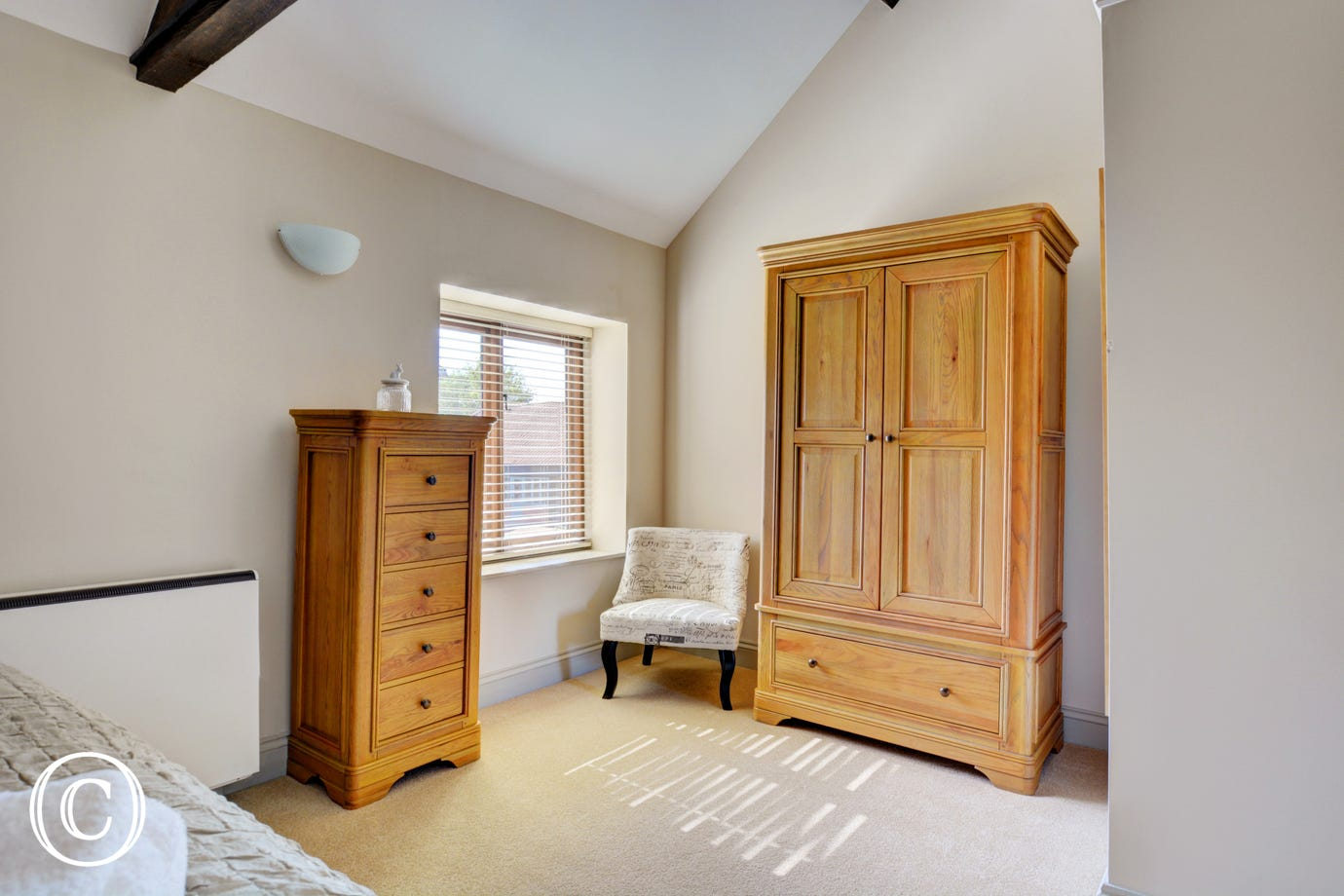 Storage and seating in bedroom two