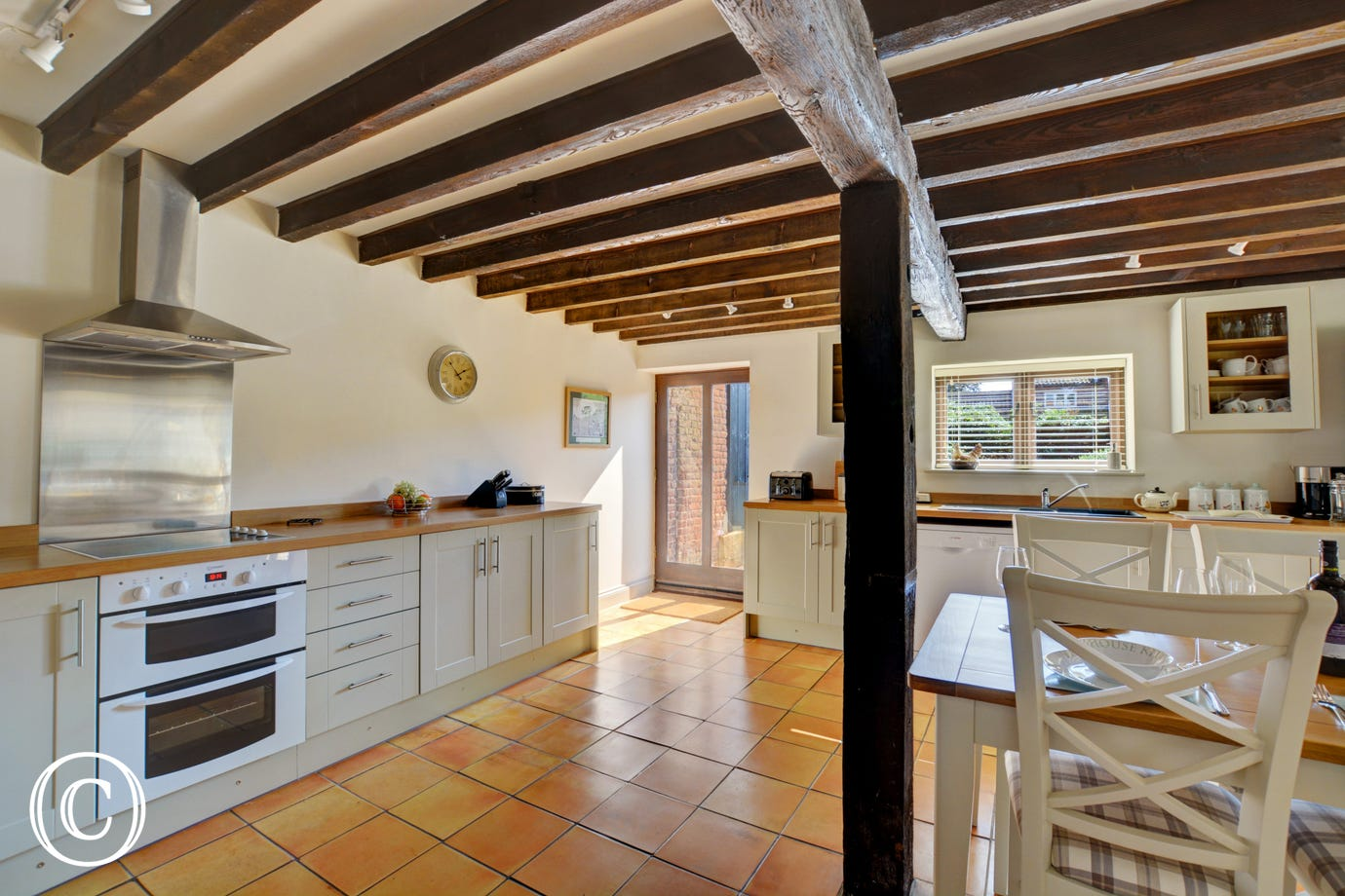 Rustic open beams in the well equipped kitchen