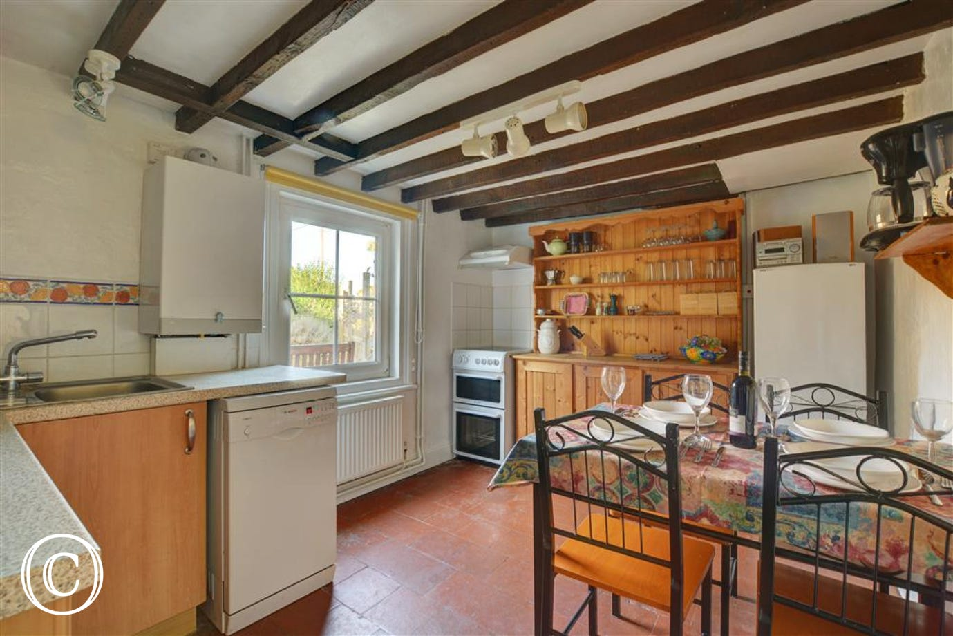 Rustic open beams within the traditional kitchen