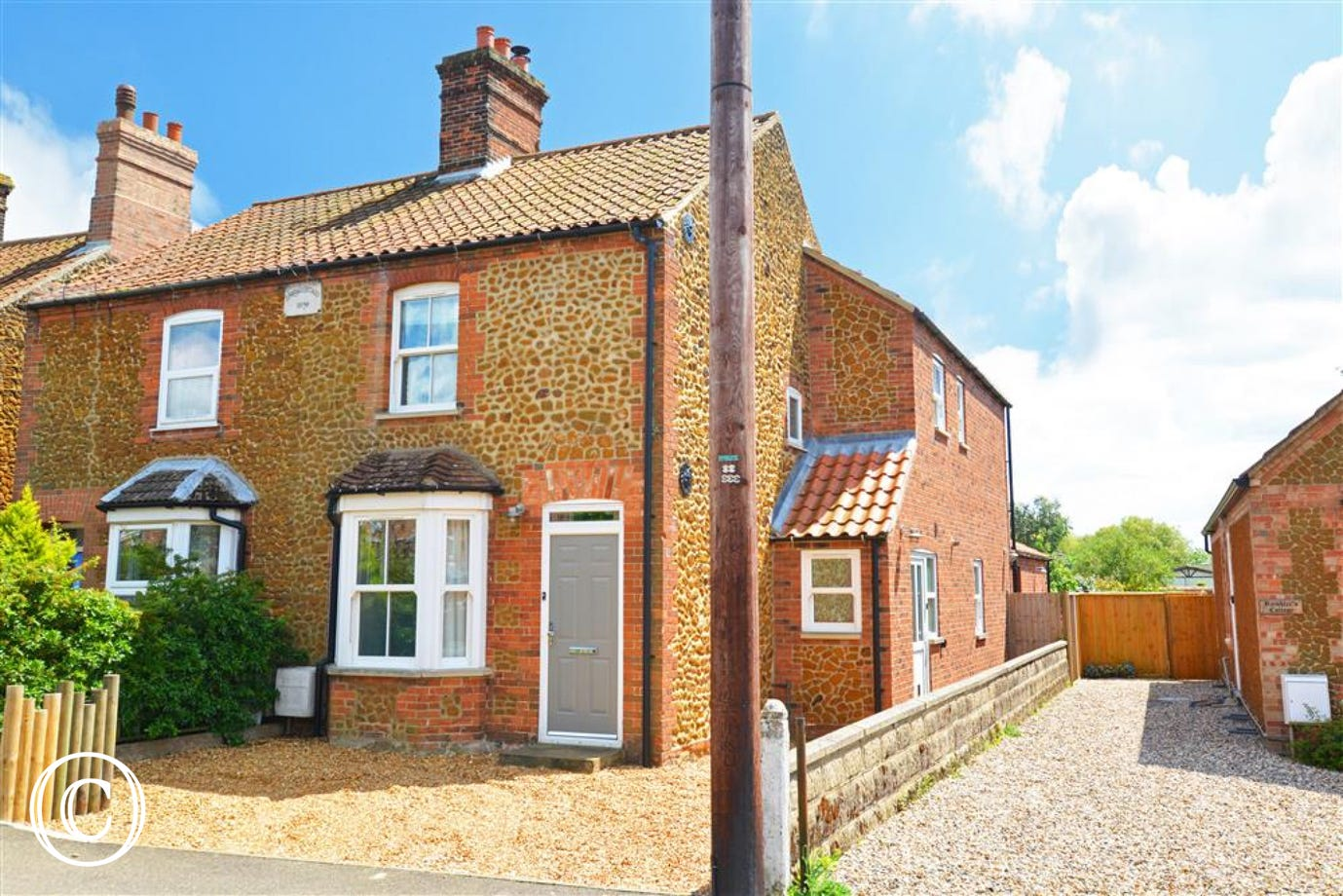 Exterior image of this traditional brick and carrstone cottage