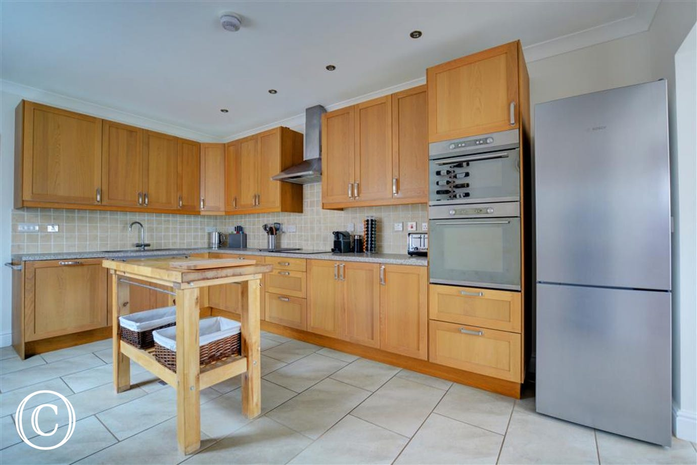 Lovely modern kitchen with electric oven and hob